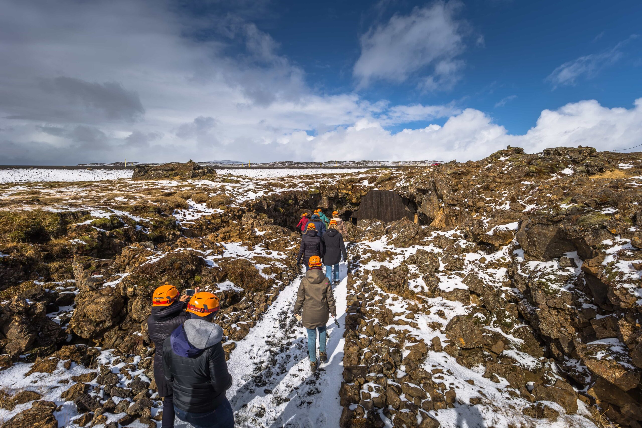 people on the way to Raufarhólshellir lava cave in Iceland
