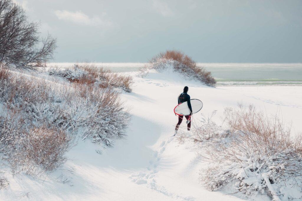 Surfing in snow in Icelandic winter
