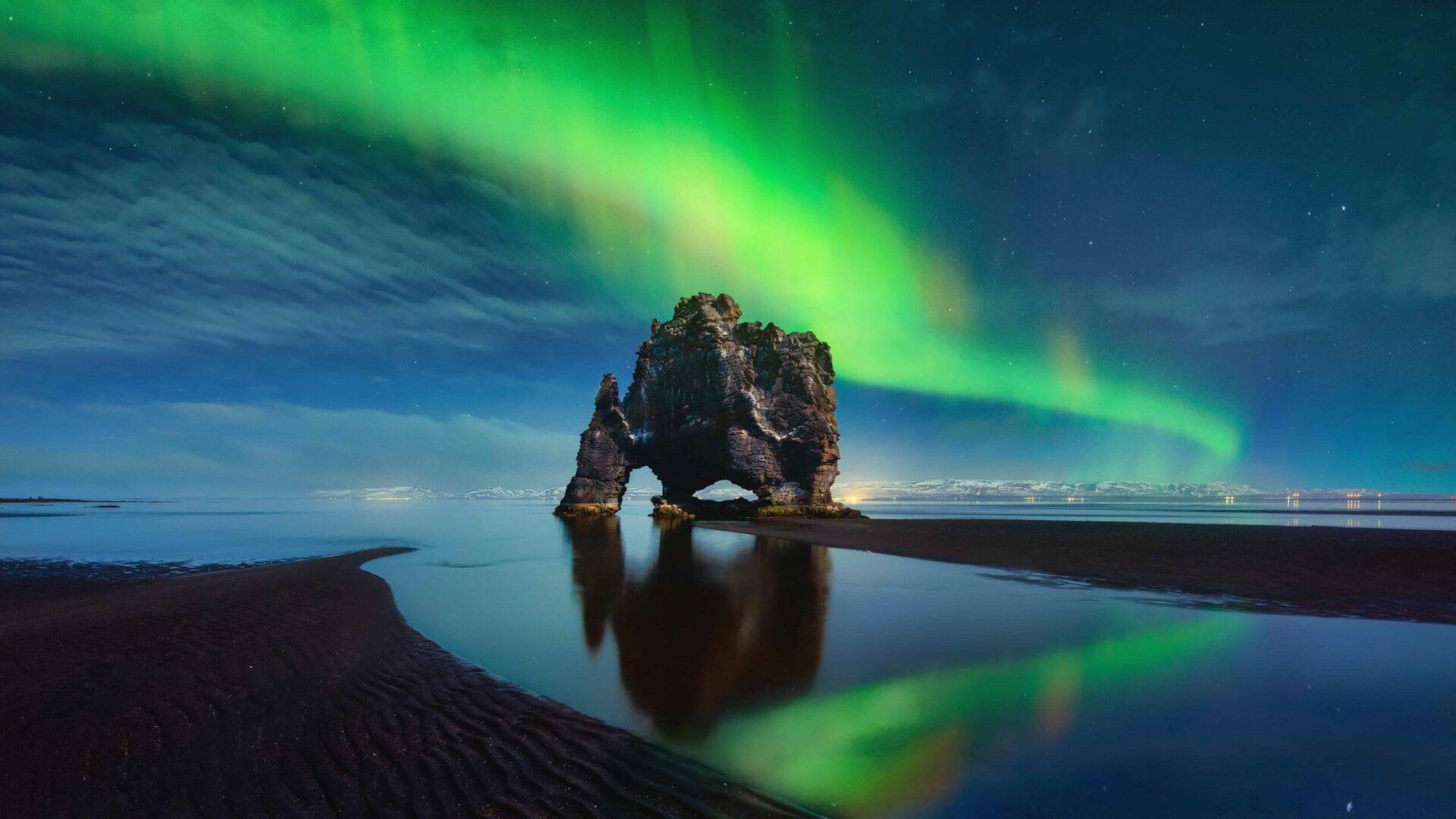 northern lights at Hvítserkur cliff in north Iceland