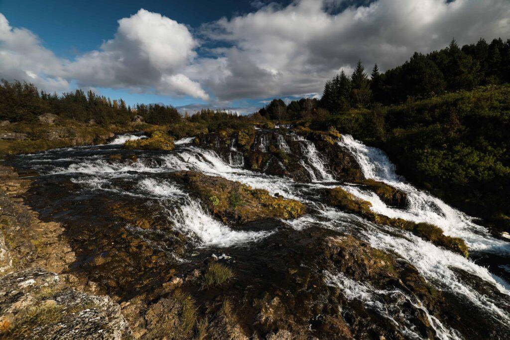 Kermóafoss waterfall in Elliðaárdalur valley in Reykjavik, hidden waterfall in Reykjavik