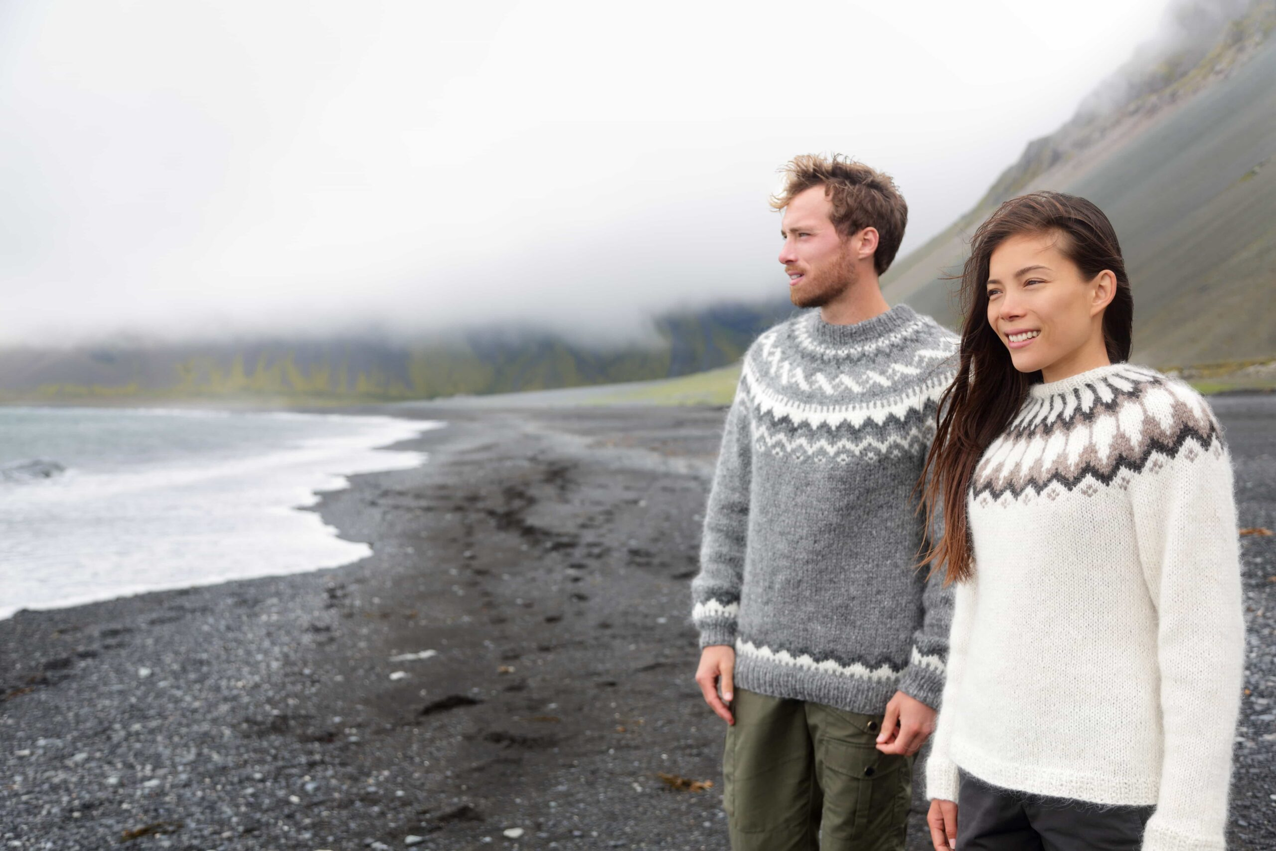 couple at the black sand beach, Honeymoon in Iceland