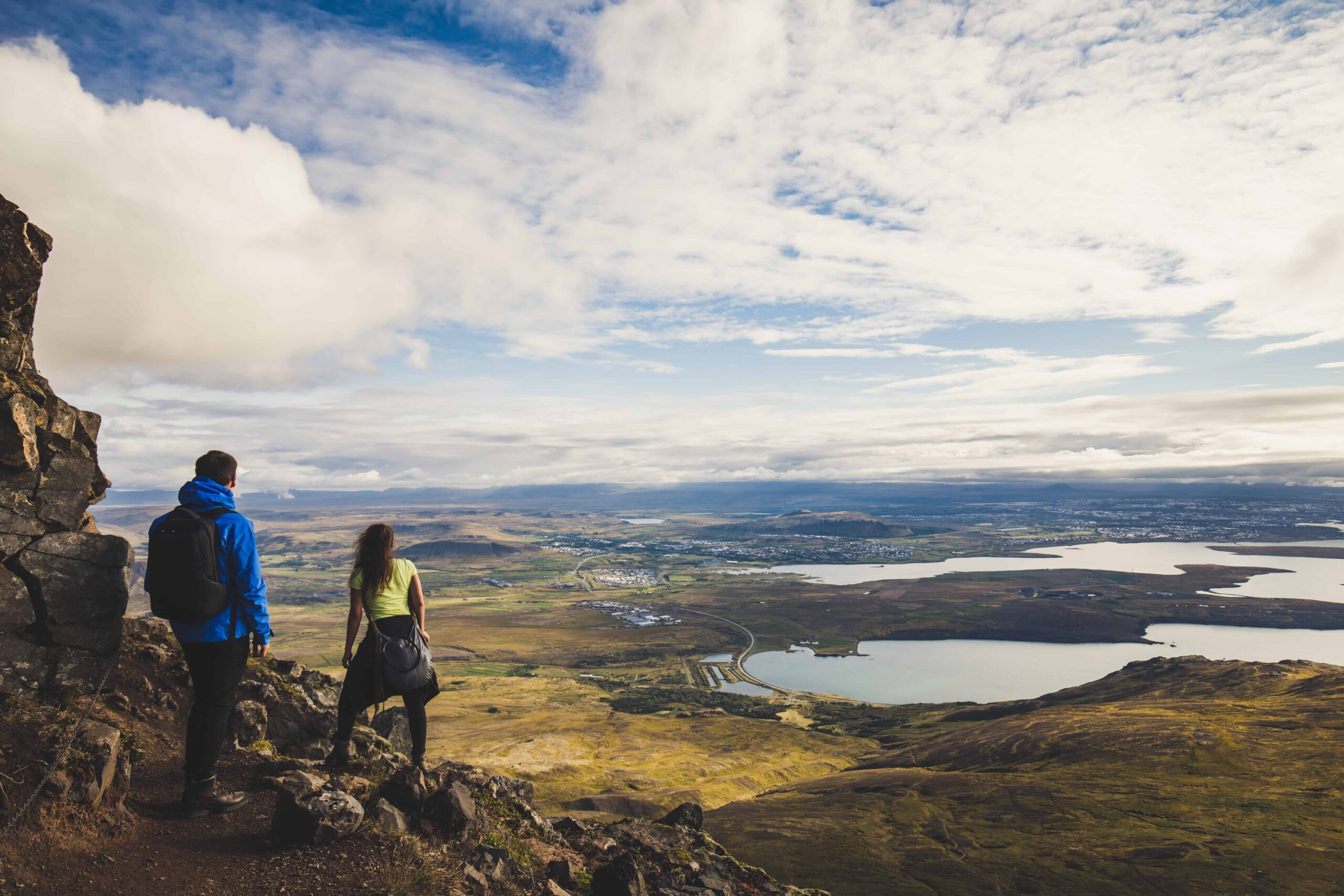 Honeymoon in Iceland, hiking on Esjan mountain with view over Reykjavik