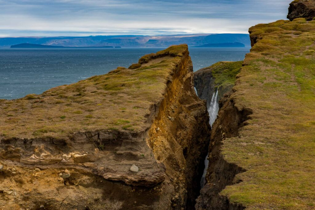 Ketubjörg cliffs and waterfall in north Iceland