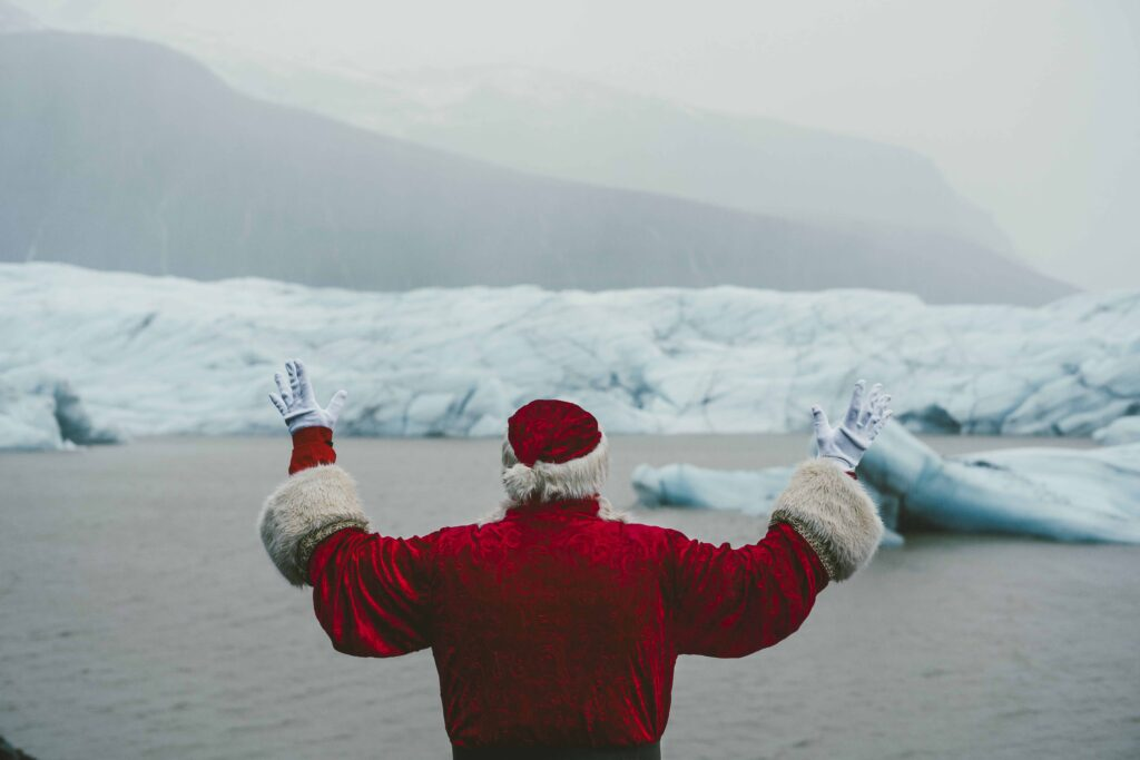 Christmas in Iceland - Yule lads in Iceland - santa claus standing in front of the glacier lagoon