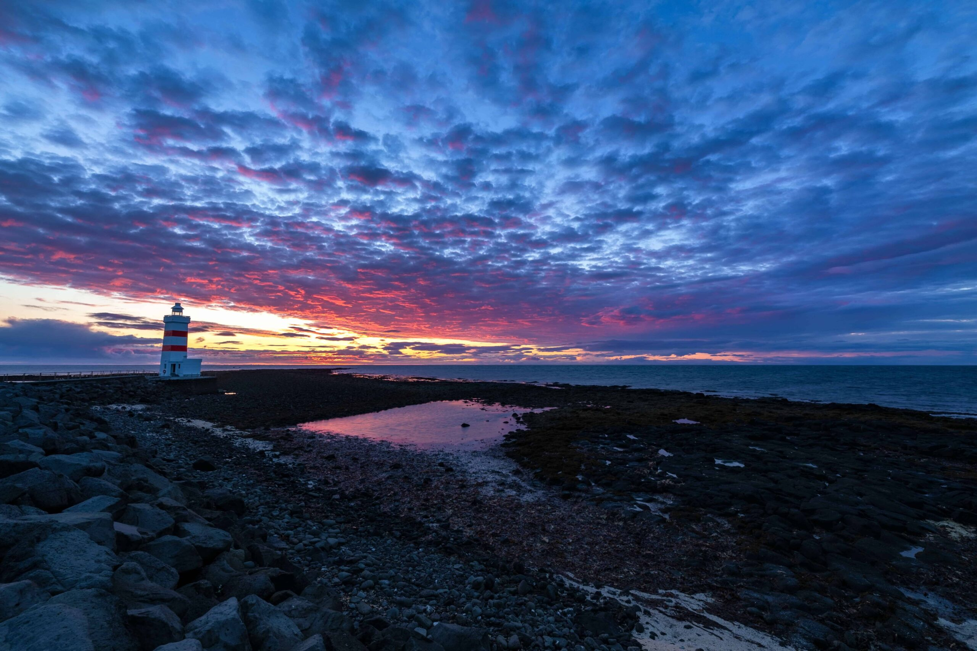 northern lights over Garðskagaviti lighthouse in Reykjanes Peninsula