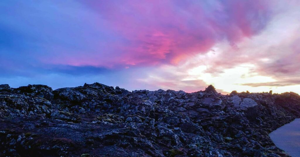 pink skies over lava fields in Grindavík Reykjanes