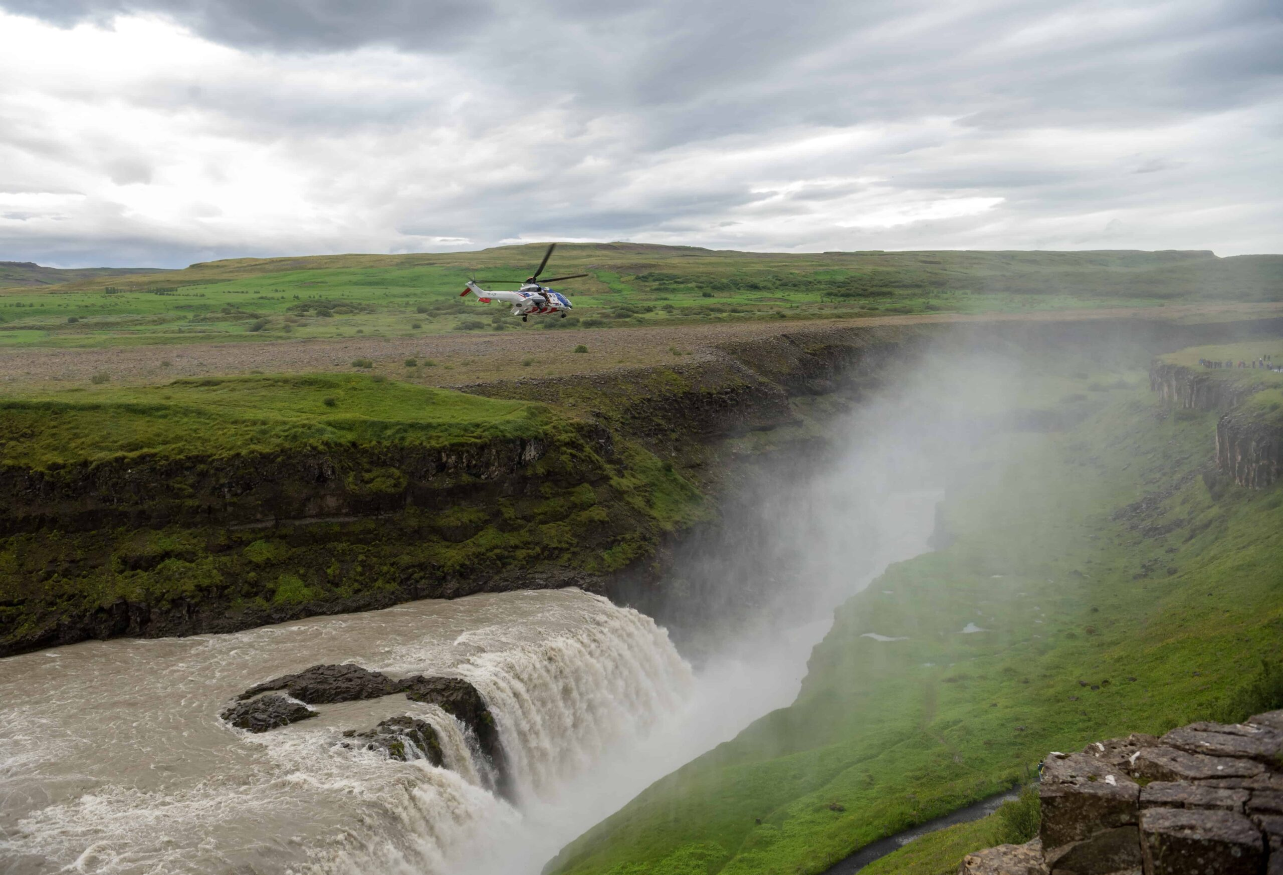 Helicopter at Gullfoss waterfall in Iceland
