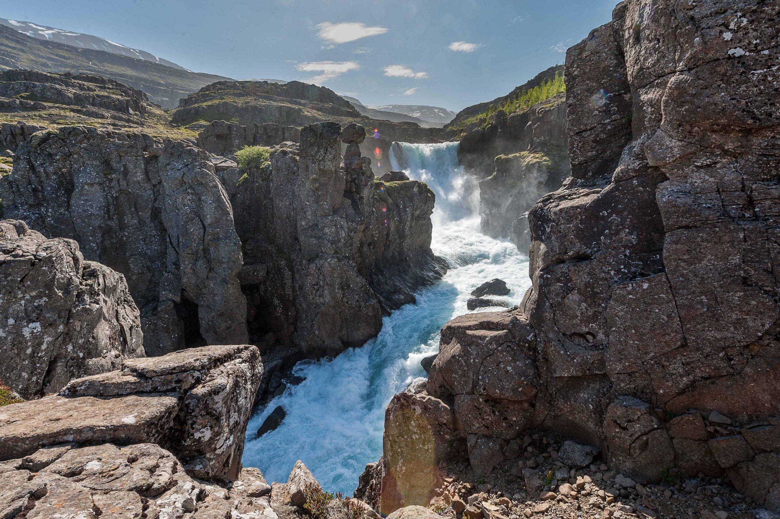 waterfall in Eskifjörður village in the Eastfjords of Iceland