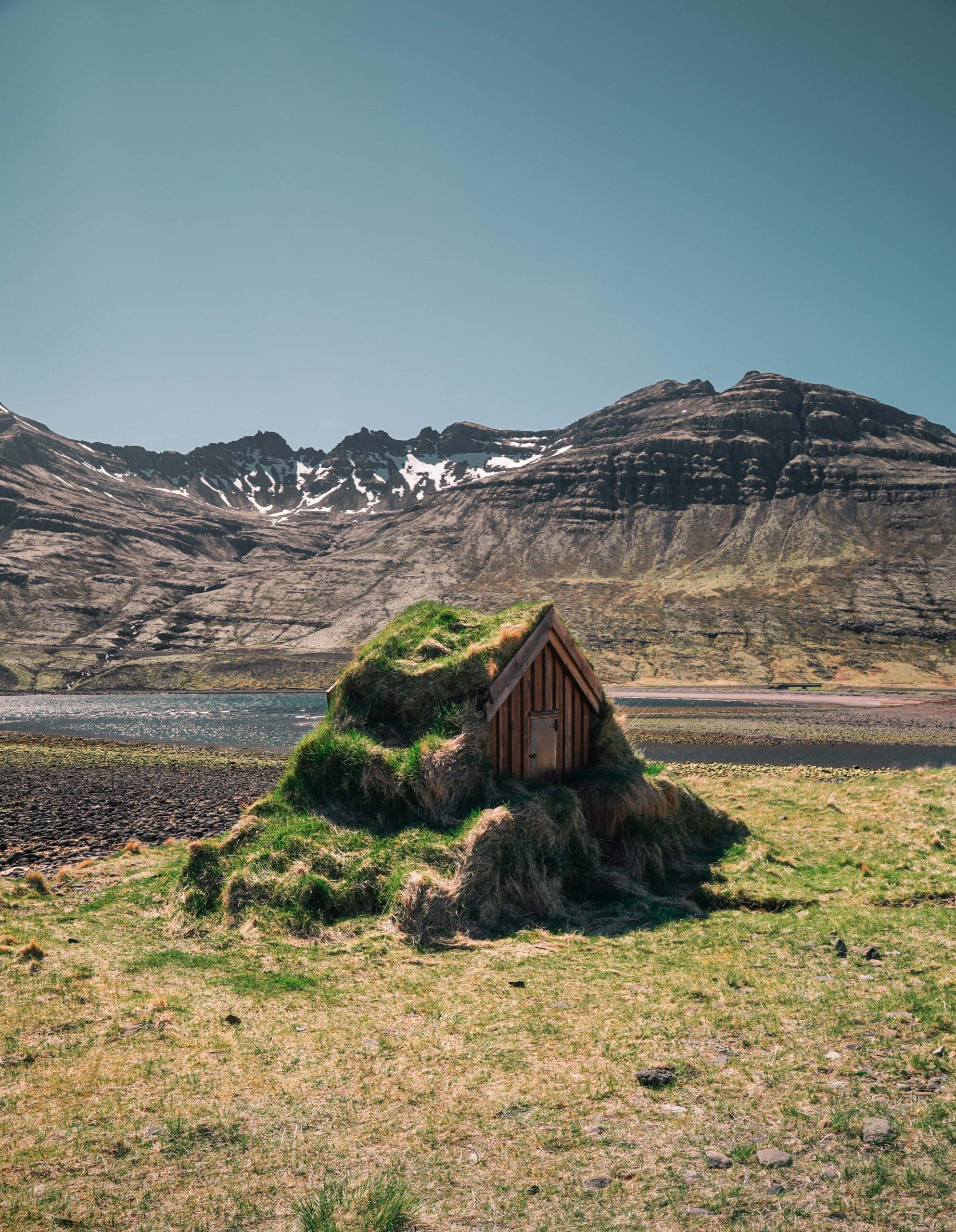 turf house in Eskifjörður village in the Eastfjords of Iceland