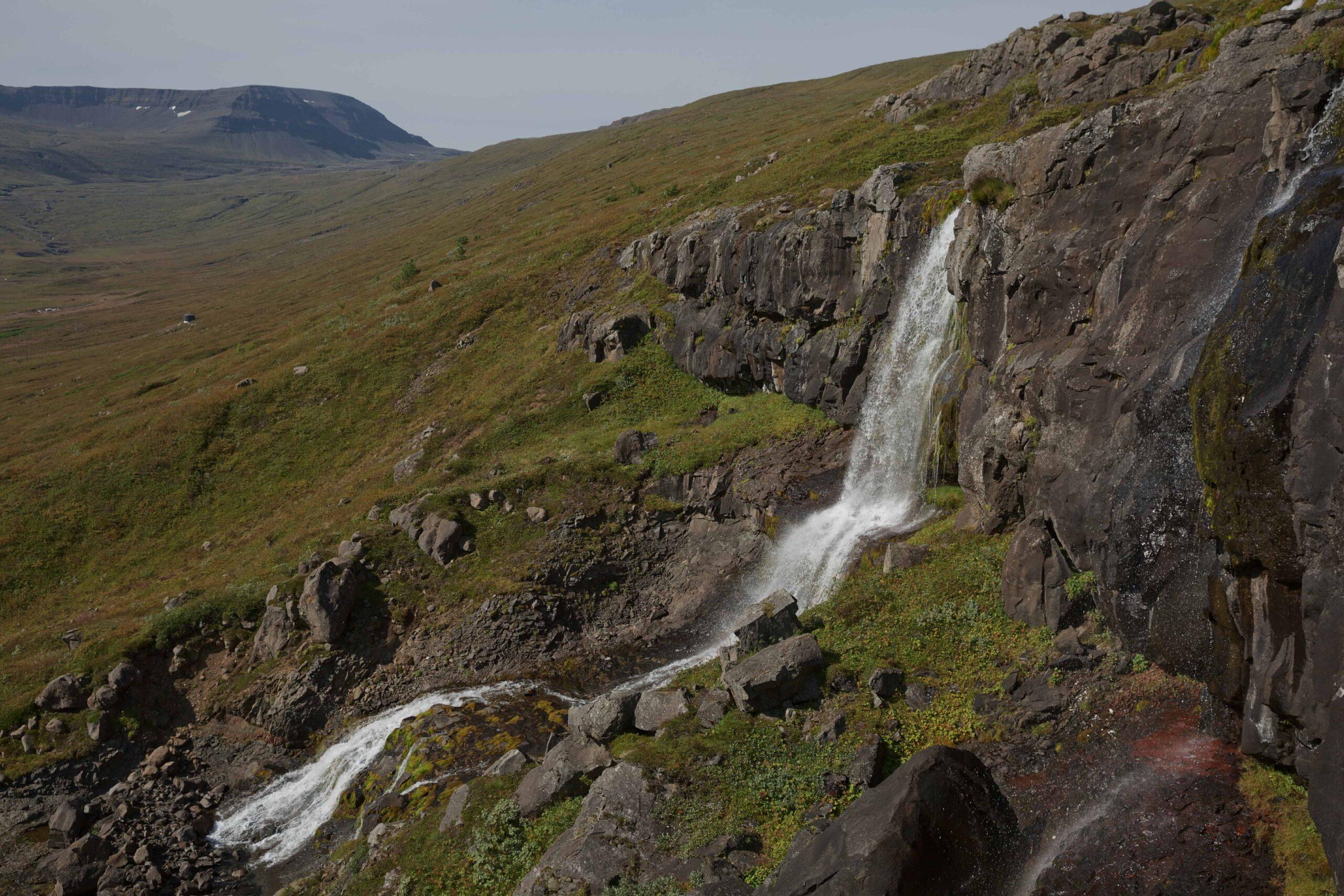 waterfall in Eskifjörður in the Eastfjords of Iceland