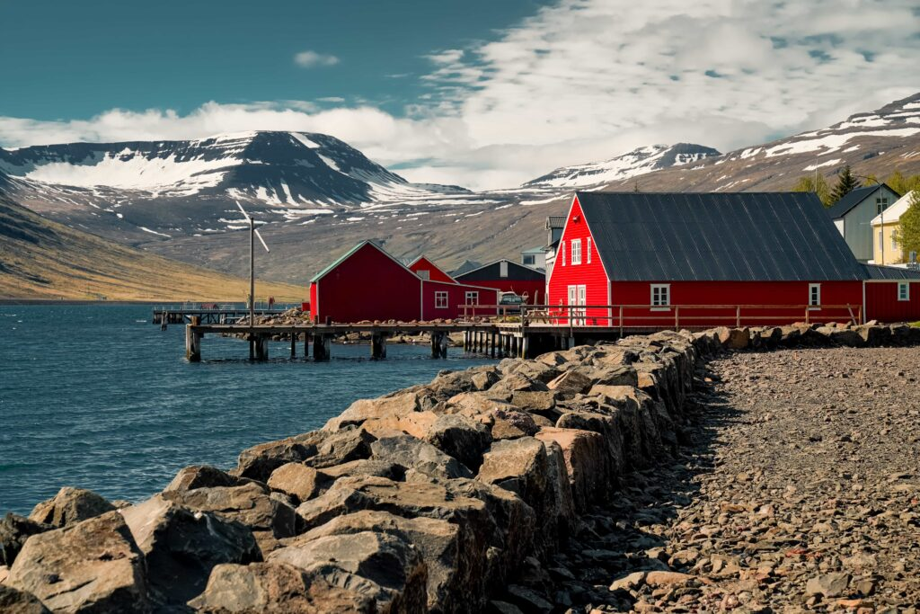 red houses in Eskifjörður village in the Eastfjords of Iceland