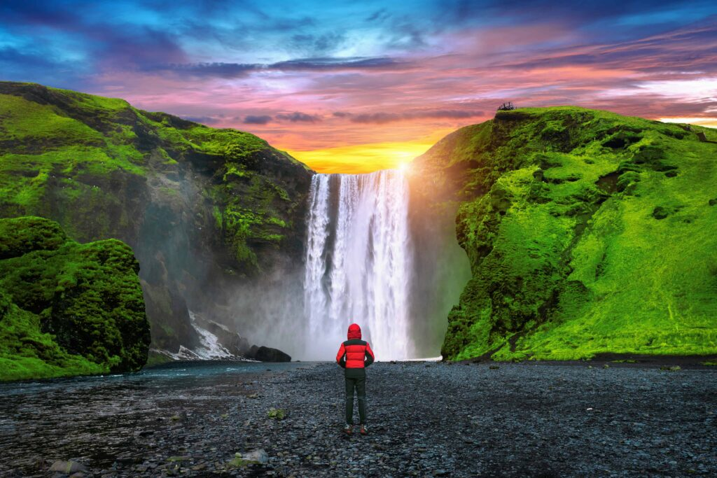 sunset at Skógafoss waterfall in south Iceland, midnight sun in Iceland