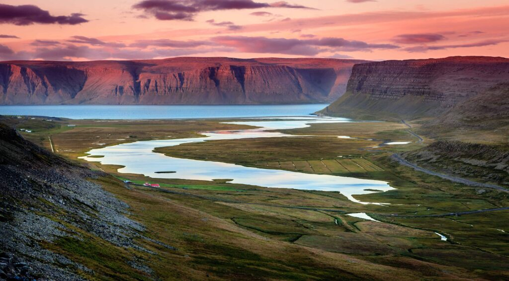 midnight sun and fjords in Westfjords in Iceland