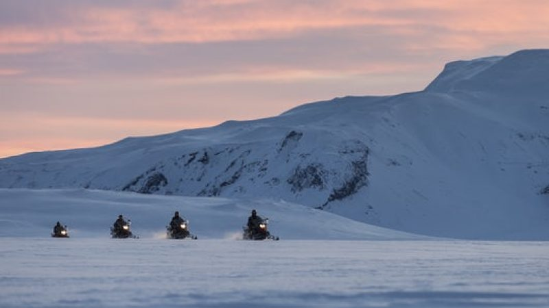 snowmobile on langjokull glacier into the glacier