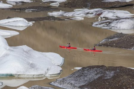 Glacier Kayaking on Sólheimajökull glacier lagoon in south Iceland