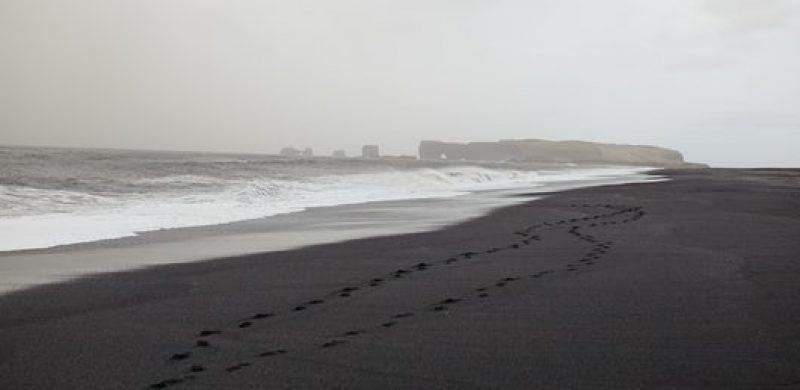Reynisfjara black sand beach with views over to Dyrhólaey in South Iceland