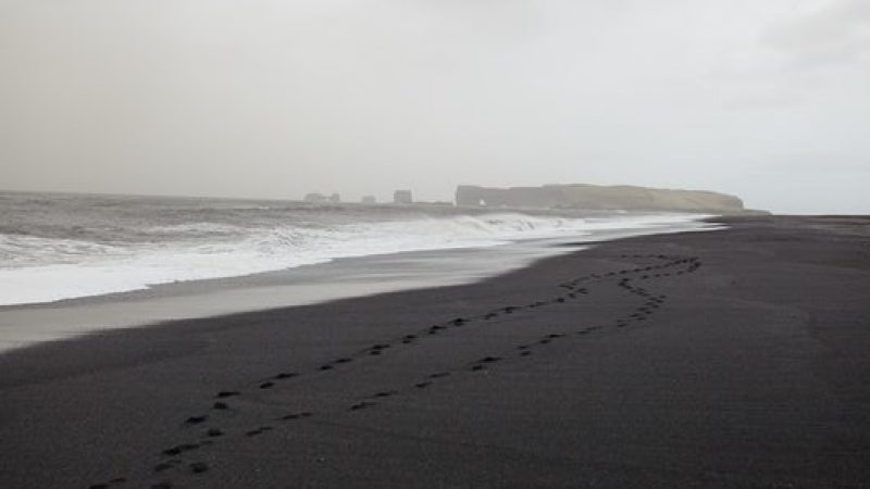 Reynisfjara black sand beach with views over to Dyrhólaey in South Iceland