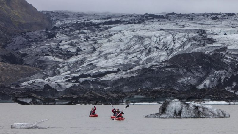 Glacier Kayaking on Sólheimajökull glacier lagoon in south Iceland