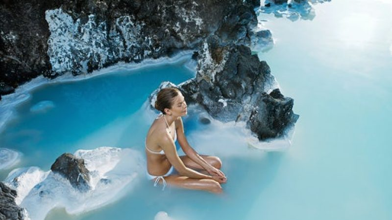 woman sitting in the Blue Lagoon in Iceland