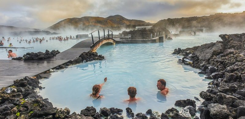 three people relaxing in the Blue Lagoon in Iceland