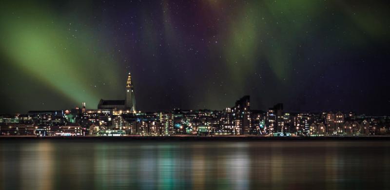 northern lights above Reykjavik and Hallgrimskirkja church