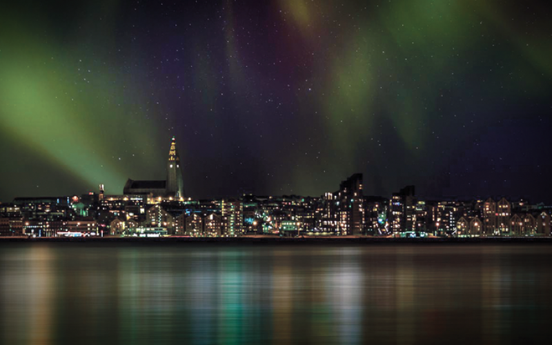 northern lights above Reykjavik and Hallgrimskirkja church