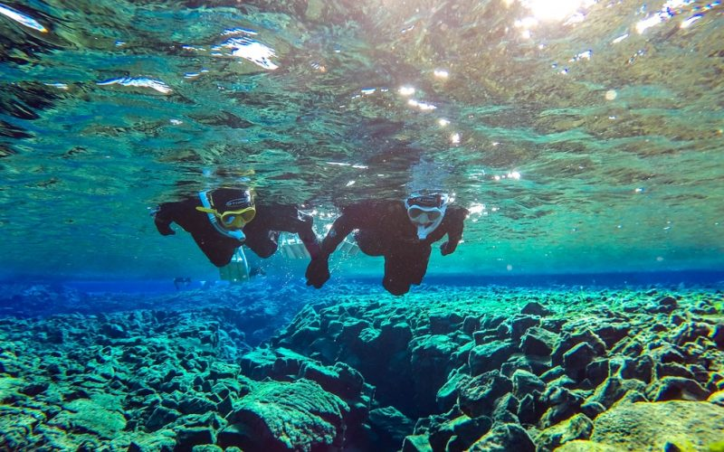 two people on a Snorkel Silfra tour in Thingvellir National Park