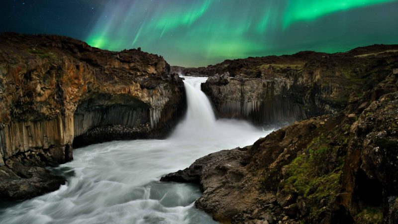 northern lights above Aldeyjarfoss waterfall in the northern highlands of Iceland