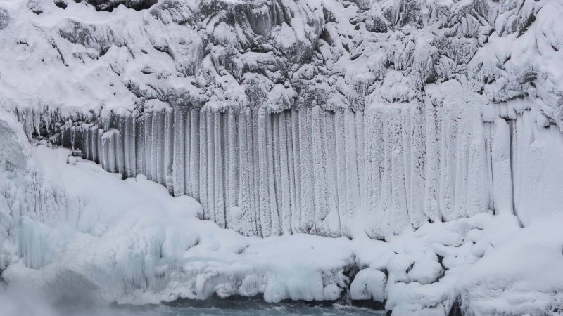 winter and snow at Aldeyjarfoss waterfall in the northern highlands of Iceland