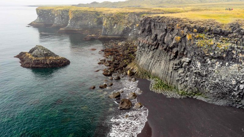 black sand beach and lava cave at Arnarstapi fishing village in snæfellsnes peninsula