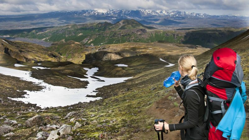 Hiking with a backpack and water bottle in Iceland