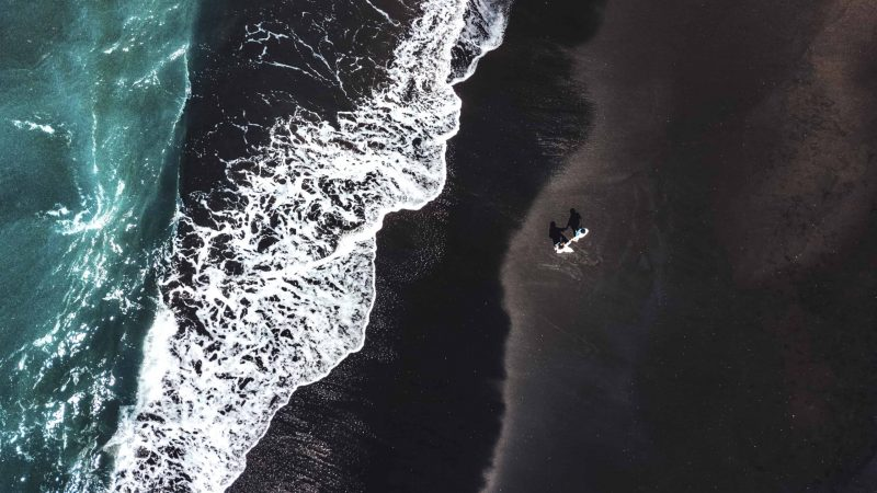 Drone flying in Iceland, Black sand beach in Iceland seen from a drone