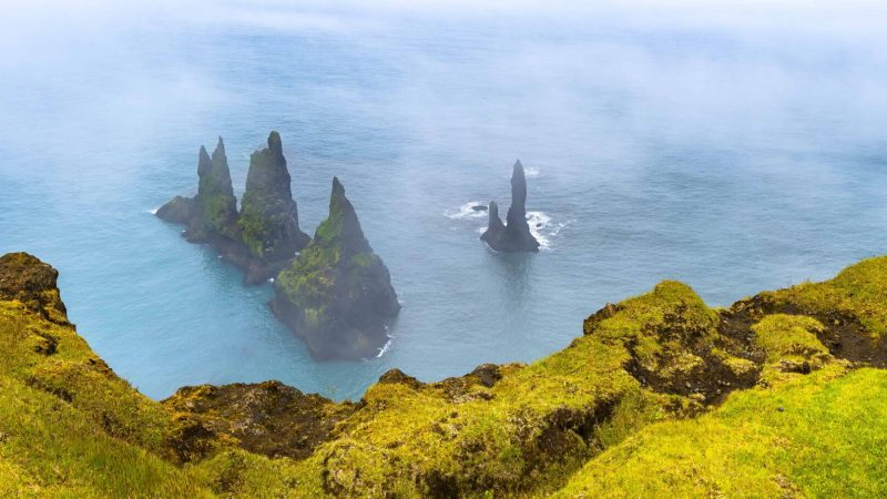 Reynisdrangar cliffs in Reynisfjara black sand beach, Trolls in Iceland