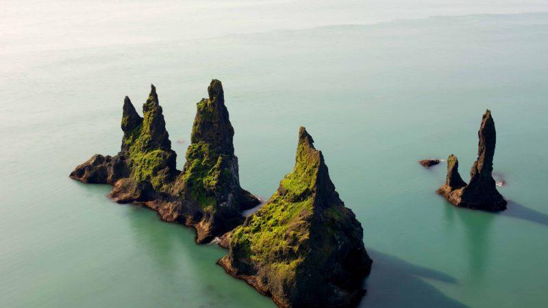 Reynisdrangar cliffs in Reynisfjara black sand beach, Trolls in Iceland