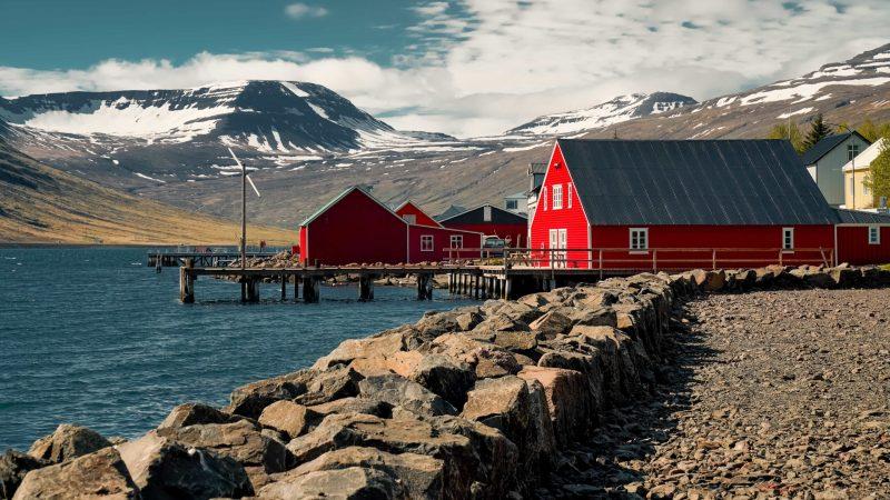 red houses in Eskifjörður village in the Eastfjords of Iceland