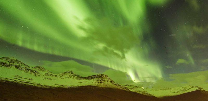 northern lights in Fáskrúðsfjörður village in Eastfjords of Iceland