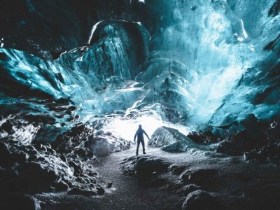 a man standing inside Katla Ice Cavel the best summer self driving tours in Iceland