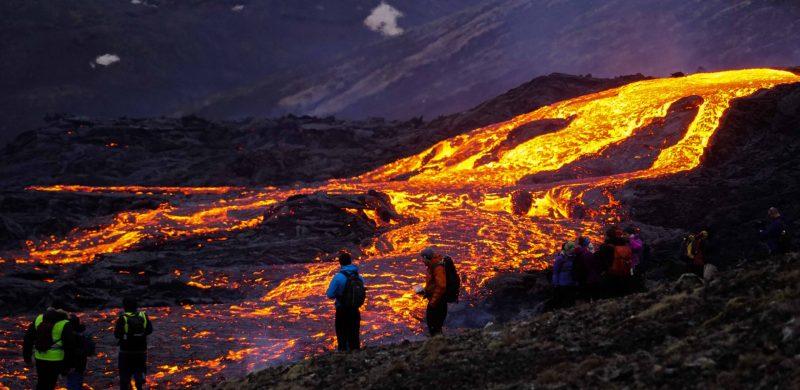 active volcano tour, people exploring the Geldingadalur erupting volcano in Iceland