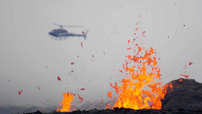 active volcano tour, helicopter flying over Geldingadalur erupting volcano in Iceland