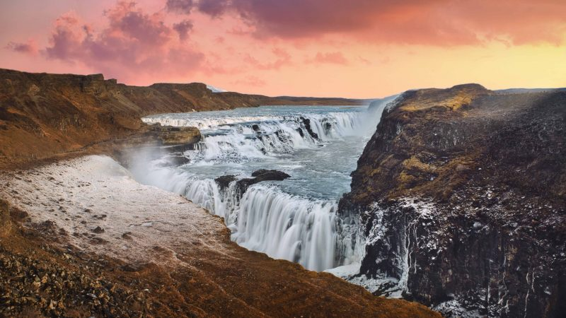 sunset at Gullfoss waterfall in Golden Circle Iceland, midnight sun at Gullfoss