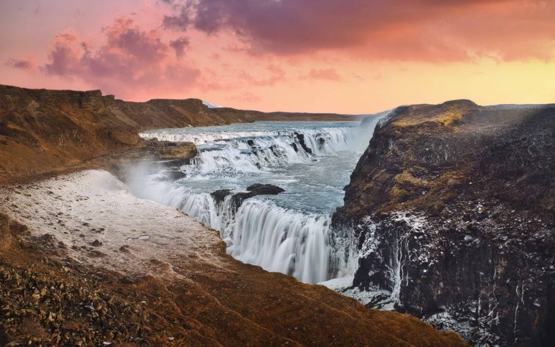 sunset at Gullfoss waterfall in Golden Circle Iceland, midnight sun at Gullfoss