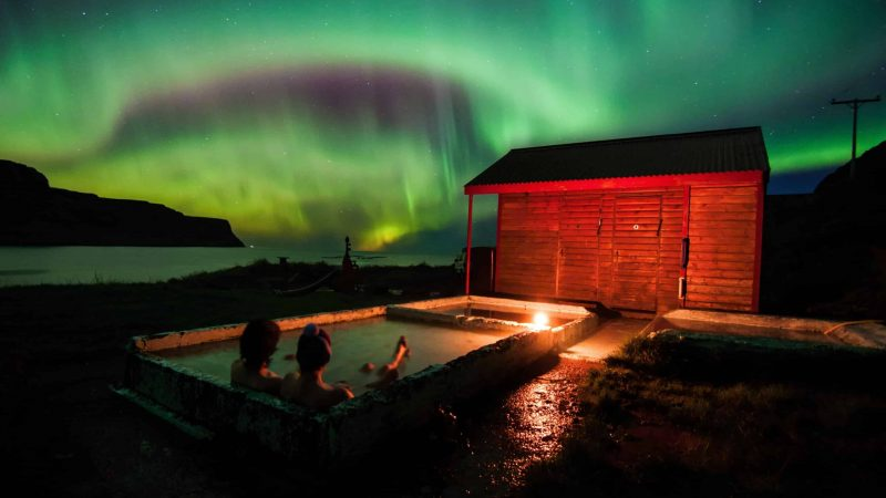 Pollurinn hot spring with northern lights, Honeymoon in Iceland, watching the northern lights from a hot spring in Iceland