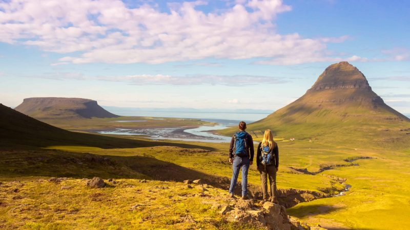 Honeymoon in Iceland, people hiking next to Kirkjufell mountain