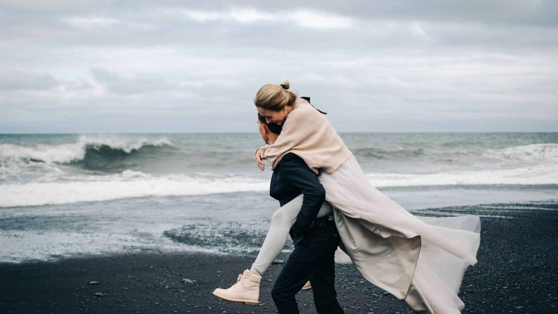 Honeymoon in Iceland, couple on the black sand beach in Iceland