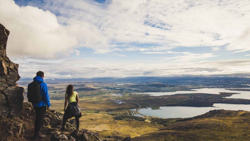 Honeymoon in Iceland, hiking on Esjan mountain with view over Reykjavik