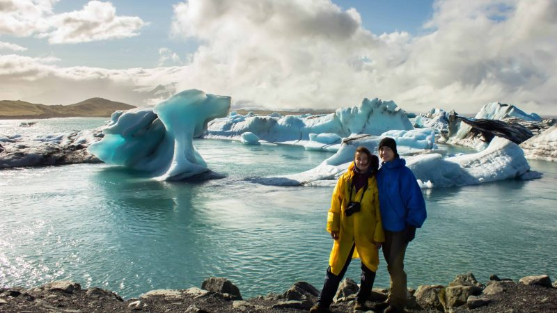Honeymoon in Iceland, two people standing in front of Jokulsarlon glacier lagoon