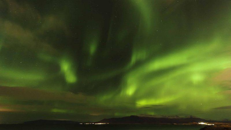 northern lights over Hvalfjörður fjord in west Iceland