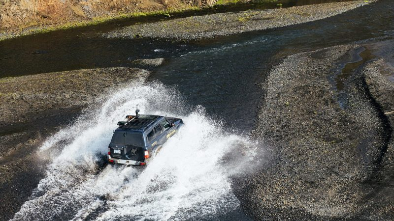 Super jeep driving over a river on a Highland Super Jeep Excursion in south Iceland