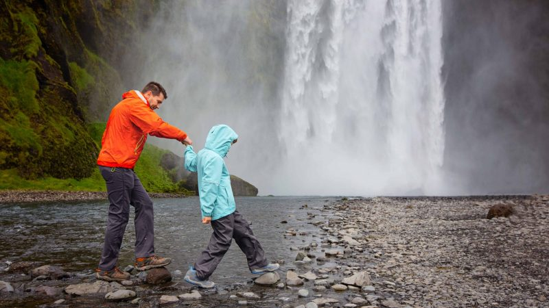 Iceland Family Travel at Skogafoss waterfall in south Iceland