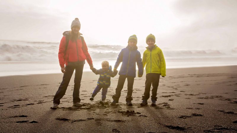 Iceland Family Travel on the black sand beach